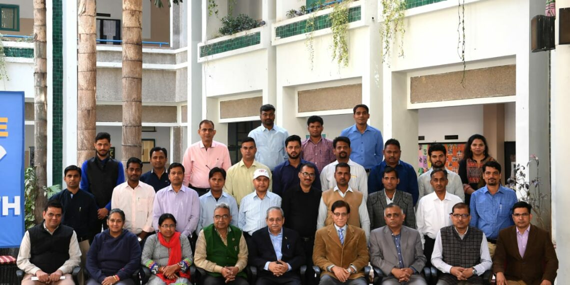 A group photograph of participants along with Kapil Kaul and BIMTECH Director - Dr H Chaturvedi follows.
